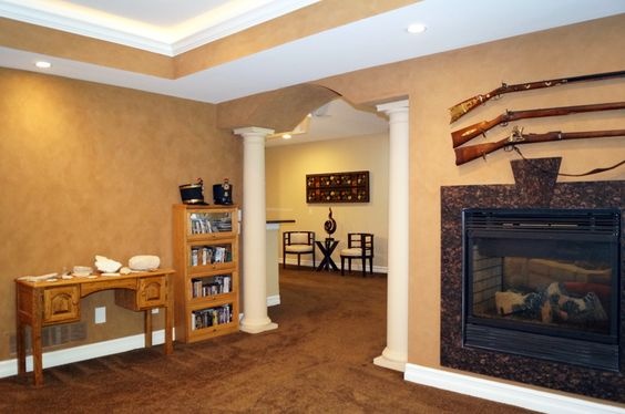 We're loving this textured wall, pairing it with a fireplace framed by some firearms really creates a rustic, yet modern feel! #Michigan #Reatestate