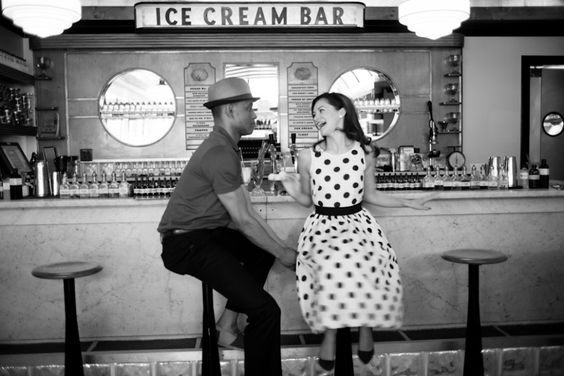 How cute is this couple? So cute. I love her polka dot dress with the ice cream bar backdrop. V. stylie