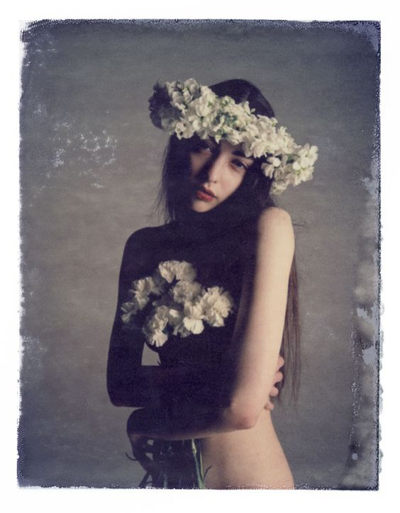 Flower garland and long hair: Aria Darcella by Pino Leone