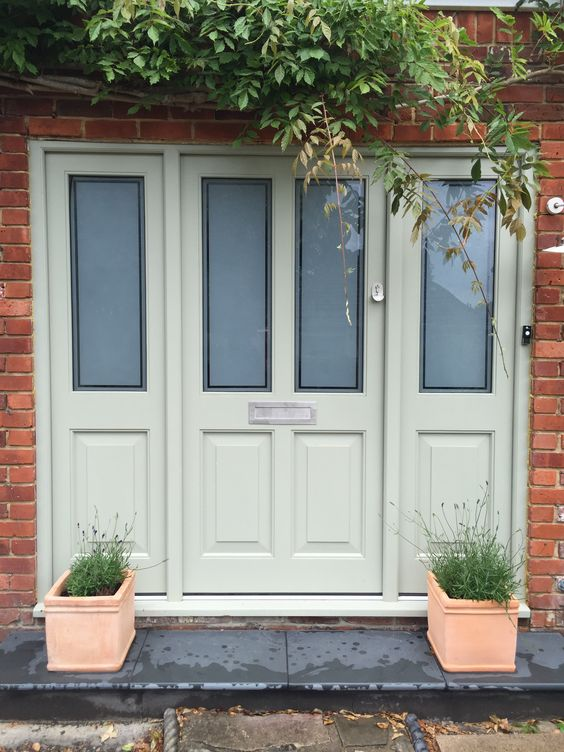 Front door painted in 'Little Greene' Normandy Grey