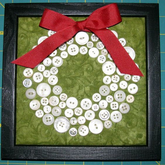 """Button Wreath! I love the contrast of the white buttons against the rich green fabric. The red bow really """"pops"""" on this!"""