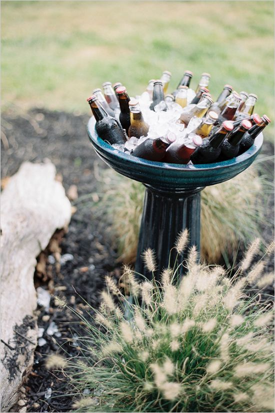 Store drinks and ice in a birdbath -- what a clever idea for outdoor entertaining!