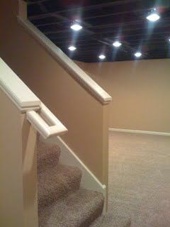 I acually love this! Instead of ceiling tiles, just paint the basement ceiling Black with recessed lights! - homysweety.com