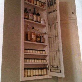 Spice rack built into wall between studs