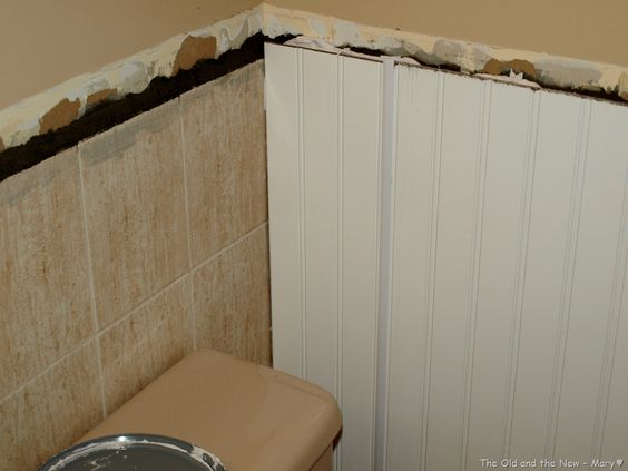 covering wall tile with wall board  Much easier and likely more affordable than tearing out. covering wall tile with wall board  Much easier and likely more