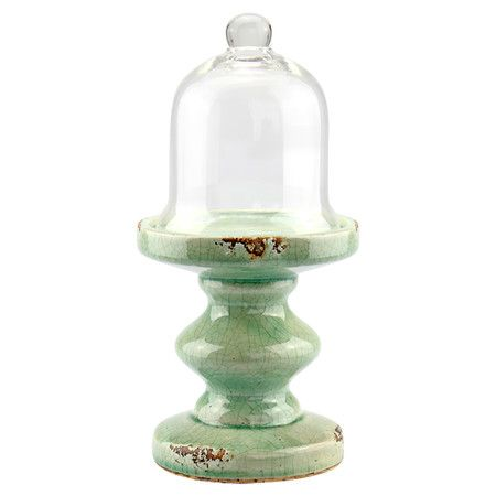 Ceramic pedestal with a glass cloche.  Product: Pedestal and clocheConstruction Material: Glass and ceramic