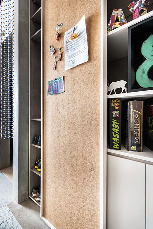 the sliding door which conceals a shoe cabinet also doubles as a cork board - Cork Cafe Decor