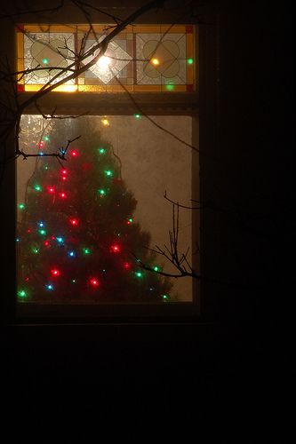 Farmhouse window glows with Christmas lights. *My favorite Christmas pin, this is so pretty*