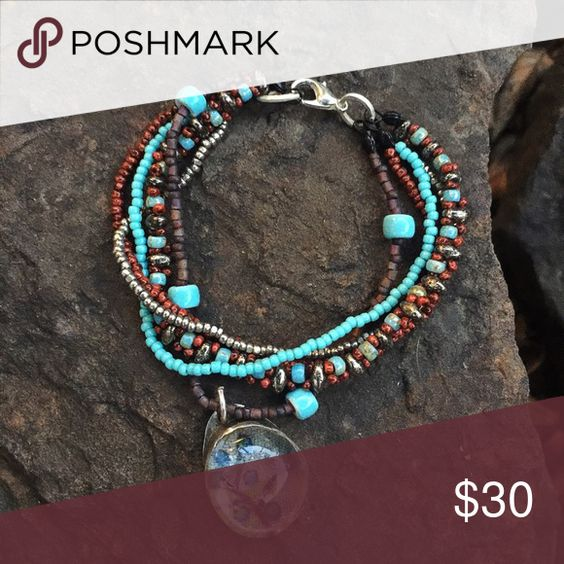 """Multi strand beaded bracelet Rows of beautiful beads in colors perfect for all seasons. Handmade Sterling and glass pendant. All Sterling components. 7"""". Original listing price $30 IEdesigned Jewelry Bracelets"""