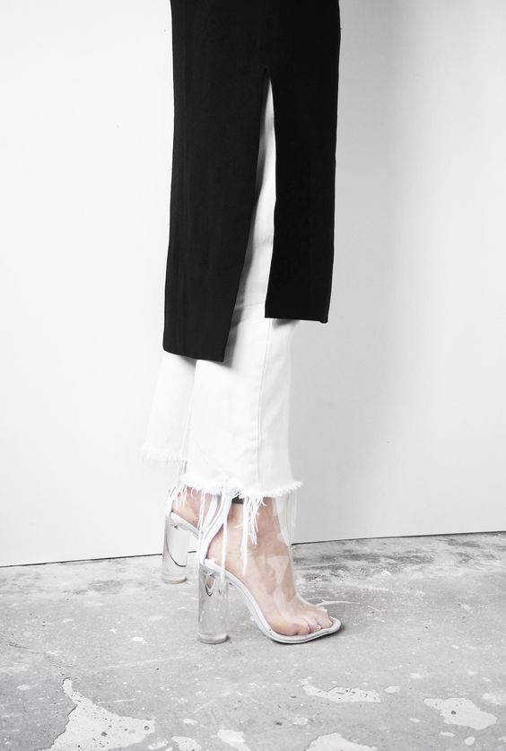 ★★★★★ five stars (white cutoff fitted jeans, black midi side slit sweater, clear plastic and white chunk heels)