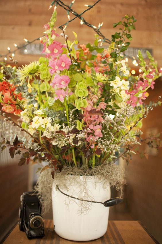 Oohhh ~ love this large ?milk pail as a container for a big floral arrangement at a rustic inspired wedding! Photography by lauren-wakefield.com, Flowers by harvestmoonflowerfarm.com