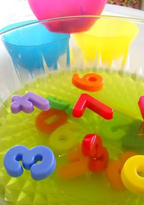 Slimey, messy play idea - sink magnetic numbers into jelly and let the kids dig them out. Great for #numeracy and #sensory play
