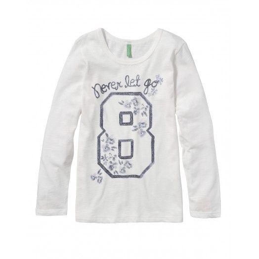 Camiseta de punto, manga larga, con detalle de lentejuelas y estampado en la parte delantera.