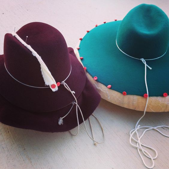 """Working with a couple of my favorite colors, deep wine red and teal blue. Blocked and drying. #millinery #hatblocks #furfelt"""