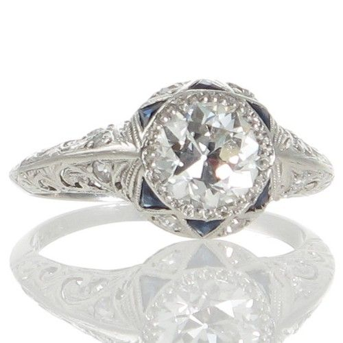 An original Art Deco 1.23ct diamond, sapphire and platinum engagement ring. www.rutherford.com.au