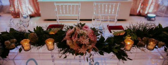 Sweet heart table, floral decor by Dahlia Occasions.
