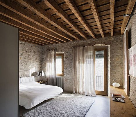 Barcelona architect Anna Noguera converted a sixteenth-century house in Girona into two contemporary holiday apartments.