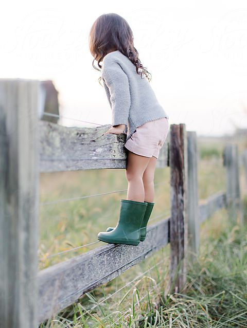 Child standing on a fence | Country Life | Farm | Ranch | Childhood Memories