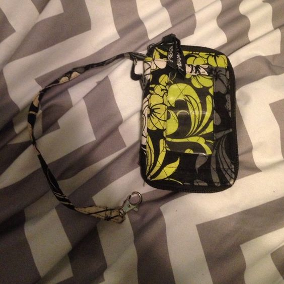 Vera Bradley wrist let Grey green and black bag you can fit ur phone in. Has a little stain but nothing a washer can't fix. Vera Bradley Bags Mini Bags