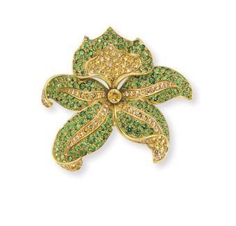yellow sapphire and tsavorite garnet orchid brooch, by Tiffany & Co.