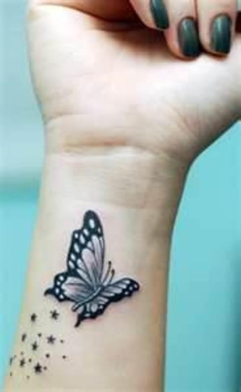 Design And Swirls Female Tattoo Design Butterfly Tattoos For Females Butterfly Tattoos Wrist Tattoos For Women Butterfly Wrist Tattoo Cute Tattoos On Wrist