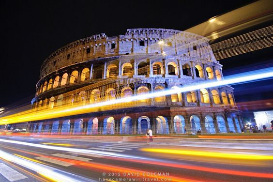 Rome's Colosseum at night with traffic lights