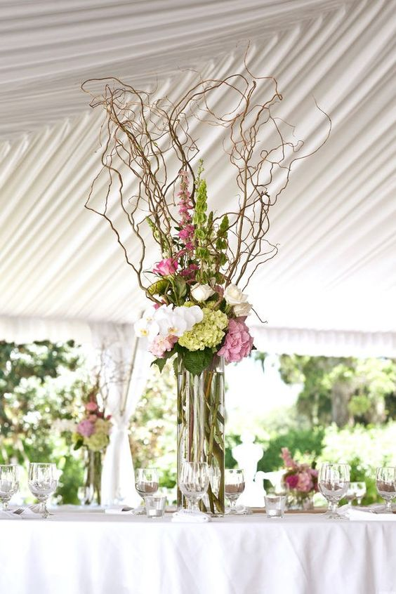 Twist on twig flower style, great high , tall arrangement with trigs, branches, bells of Ireland, hydrangeas,snapdragon , seasonal flowers, love pintrest better than having to make samples all the time.