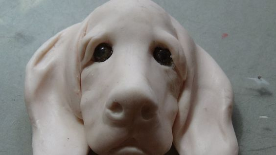 Sculpting a dogs head #pawgustart #sculpture polymer clay