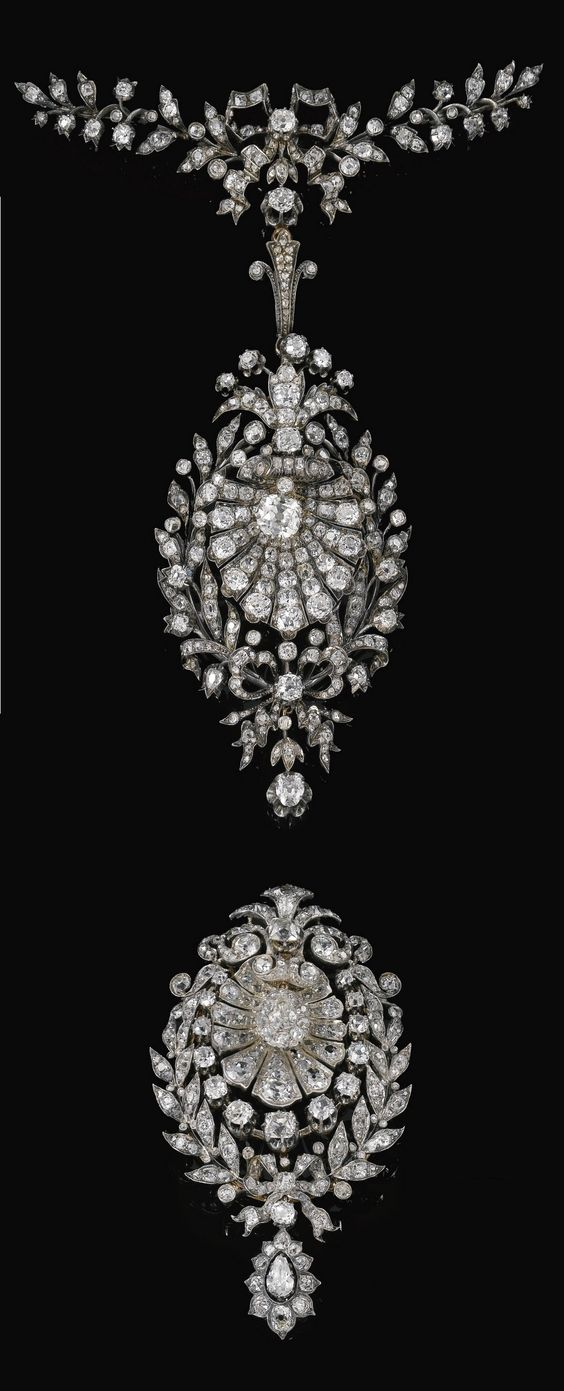 An antique diamond pendant and diamond pendant/brooch, circa 1880. Each pendant designed as scallop shell within a foliate and ribbon frame, set with cushion-, pear-shaped, circular-, single-cut and rose diamonds, additional articulated foliate and ribbon surmount en suite.