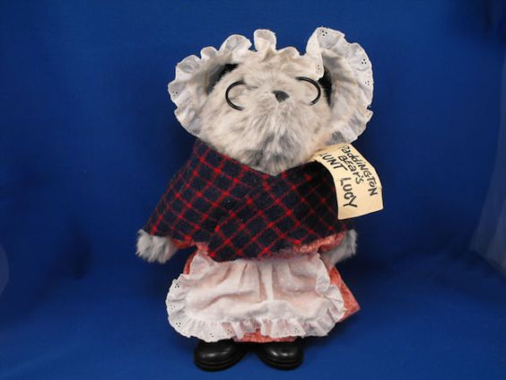 New product '1983 Eden Paddington Bear Aunt Lucy PERU COSTUME Boots Tag' added to Dirty Butter Plush Animal Shoppe! - $8.00 - 1983 Eden Plush 13 inch Standing Paddington Bear Aunt Lucy Heather Gray Bear - Black Ears - Attached Black Plastic Glass…
