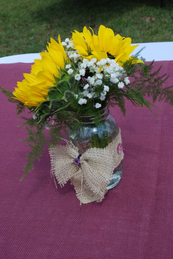 Great centerpiece just a couple of loose sunflowers and