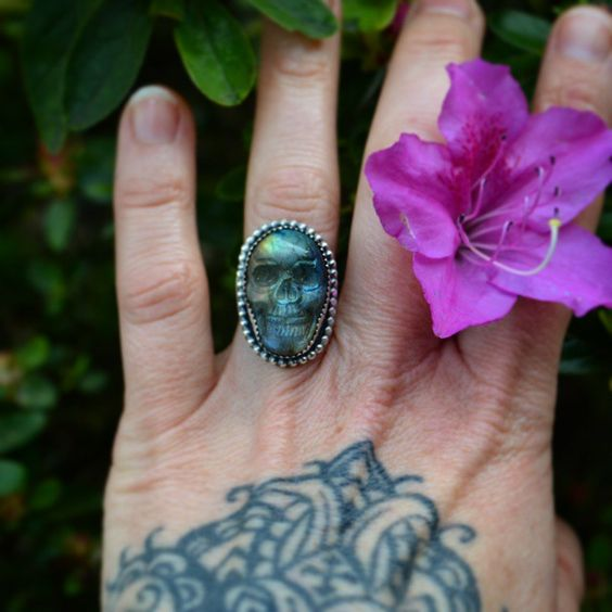 """Little carved labradorite Necromancer ring. The setting on this is  substantially smaller than my previous carved skull rings. Size 6.25 with a hand…"""