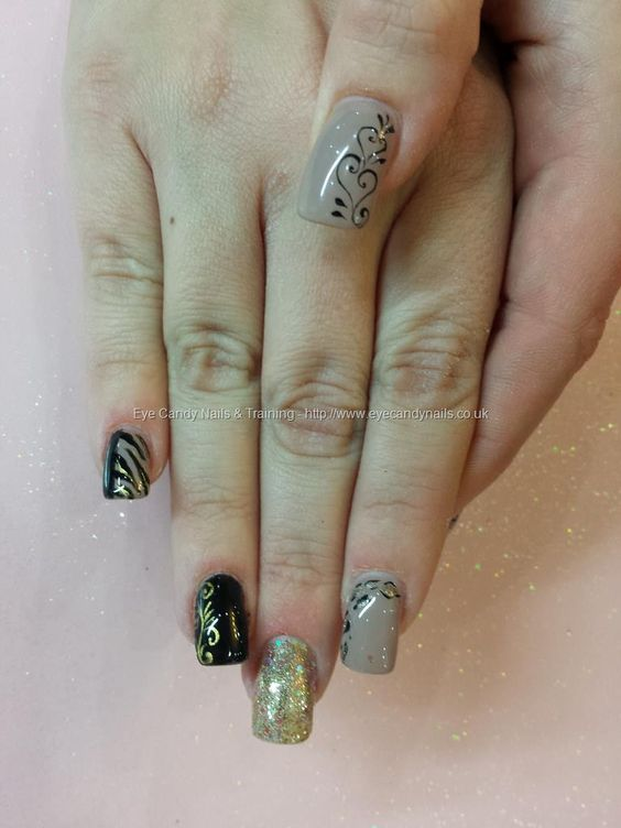 Nude and black gel polish with freehand gel nail art