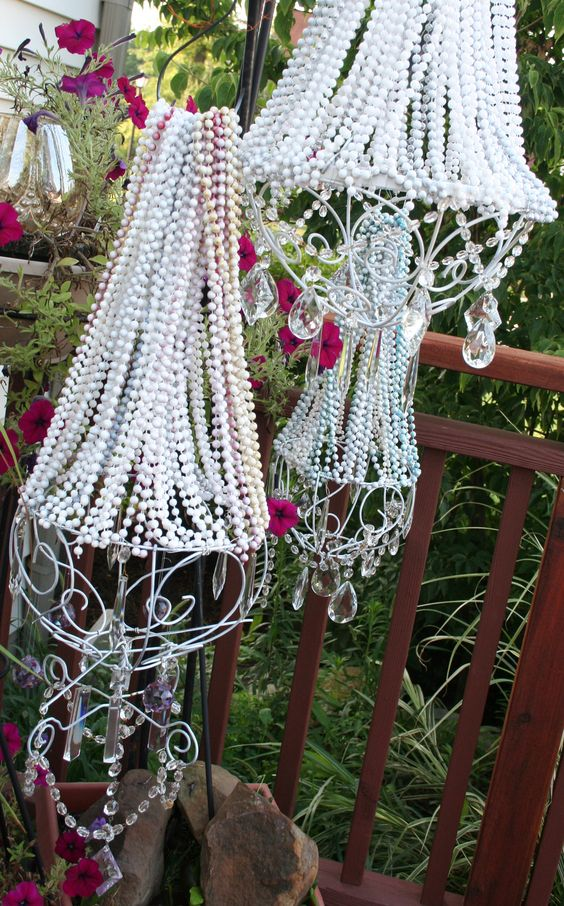 I made these garden chandlers from mardi gras beads, metal planters, old crystals and spray paint. I put lights in them...lovely at night