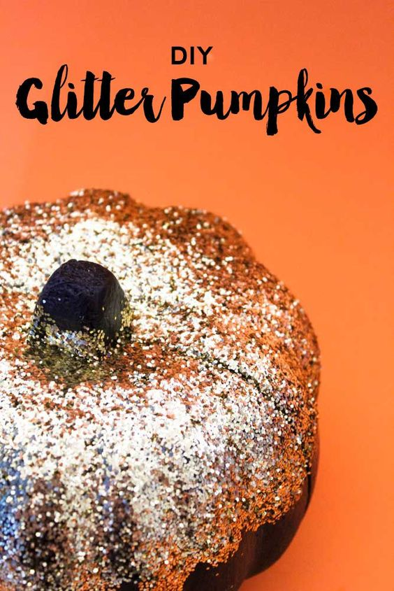 Use Dollar store items to create chic glitter pumpkins in minutes! For you halloween and fall home decor. Black and Gold Pumpkins | Decorated Pumpkins | Fall home decor | White and Purple | Do It Your Freaking Self