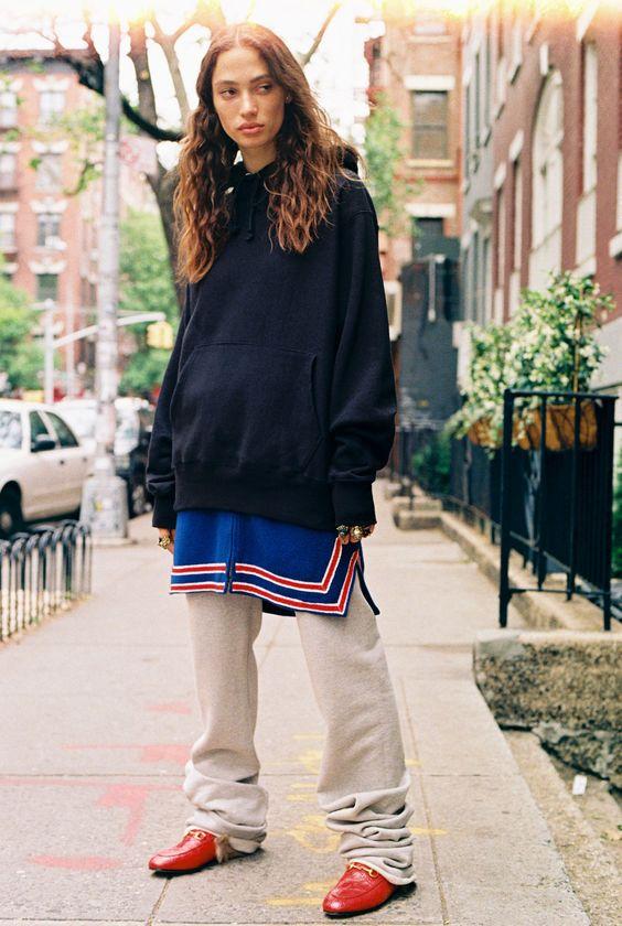 Sophie Koella in a black hoodie, vintage blue and red top, vintage track pants, and Gucci Princetown slippers
