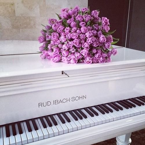 Lovely white piano and the inspiration of a bouquet http://pinterest.com/cameronpiano