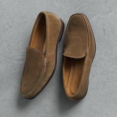 These look pretty cool.  Marc Anthony Slip-On Shoes for guys at Kohl's.