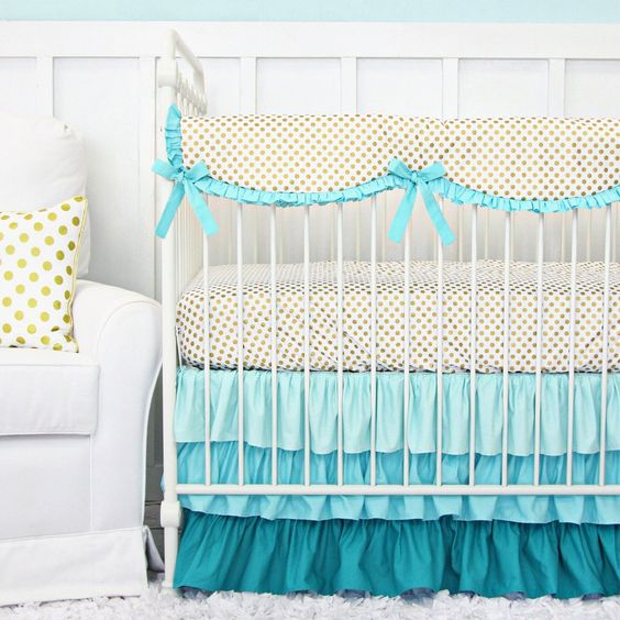 Frilly aqua, teal, and gold bedding by Caden Lane adds a luxurious touch to your nursery.:
