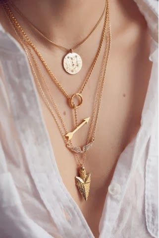 I like the middle necklace that has the arrow through the hoop