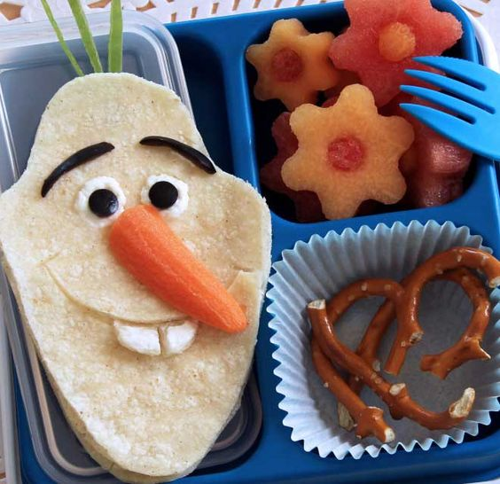 Made with a corn tortilla and fresh veggies, this Olaf-inspired bento box will satisfy anyone with Frozen Fever.