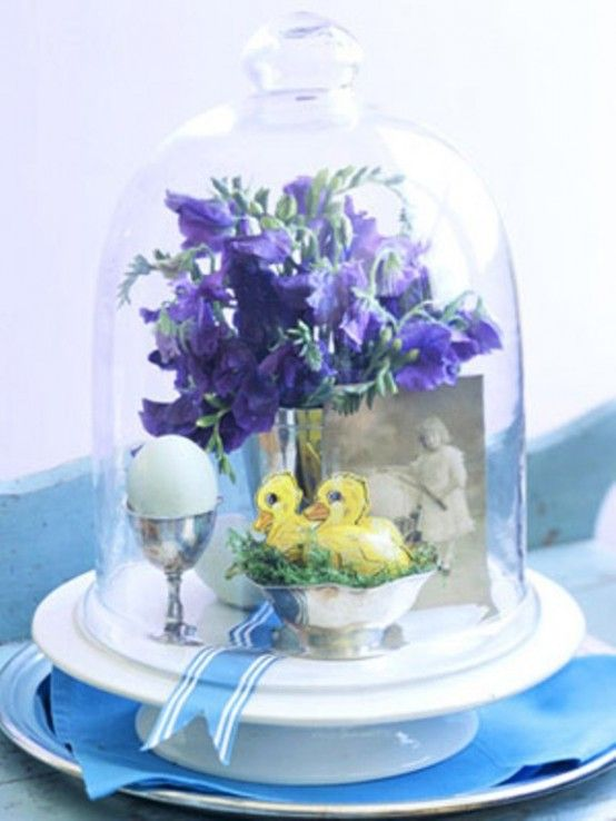 Cloche display with vintage photo, spring flowers, faux chicks, egg in cup all tied-up with ribbon for a delightful seasonal display piece.
