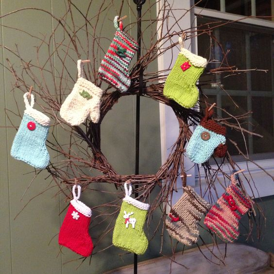 Knitted stockings and mittens by Soap Creek Design