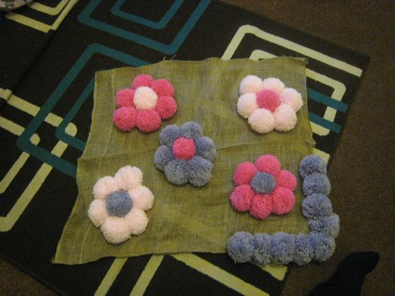 The little pom pom rug I am in the middle of making for my daughter's room.
