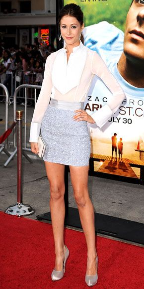 Amanda Crew in white tuxedo-inspired shirt, sequined mini, metallic pumps, and VBH clutch