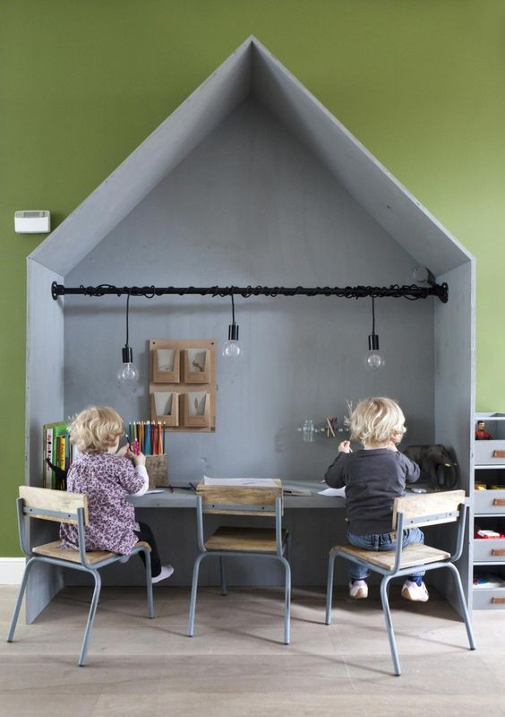this house shaped shared desk is cosy but informal perfect to concentrate and also enjoy what they are doing it also offers a lot of space to perform amazing playroom office shared space