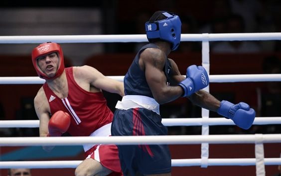 Terrell Gausha knocks down Armenia's Andranik Hakobyan during preliminary match