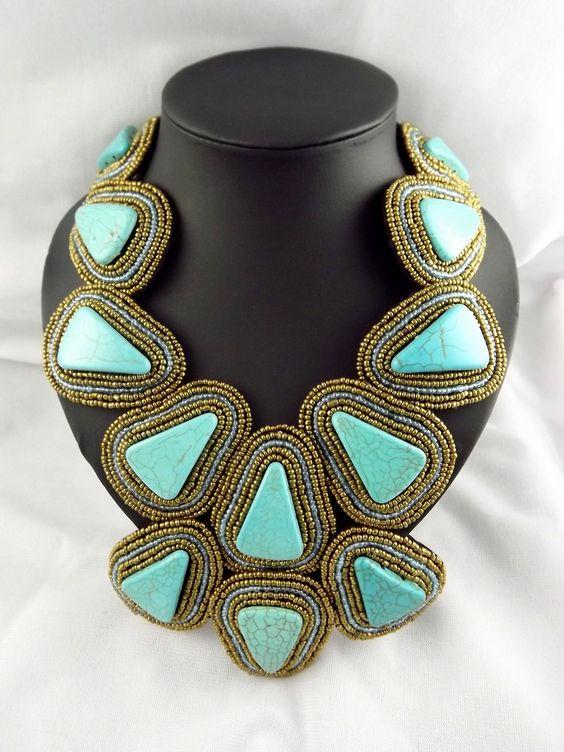 Ravishing Triangular Turquoise Semi Precious Bib Necklace Adorned with Gold Beads.: