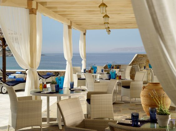 Wonderful Greek specialties are served from the sumptuous Dolphin of Delos Restaurant with its magnificent sea views. Mykonos Grand Hotel & Resort - Greece