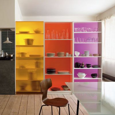 These colorful shelves act as room dividers and storage pieces. Three IKEA  Billy Bookcases were